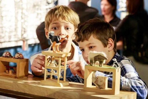 Two boys playing with automata at The MAD Museum